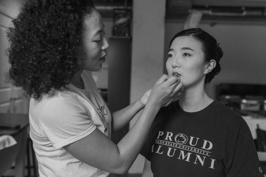 Carla Pressley applies lipstick to the bride.