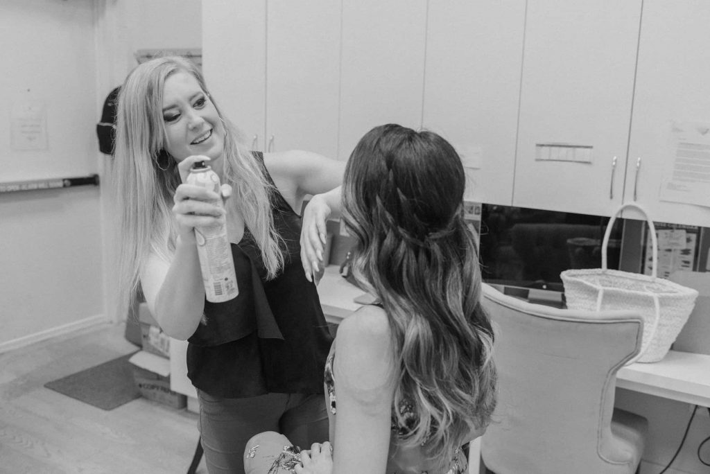 Heather Leiss puts the final touches on the model's hair.