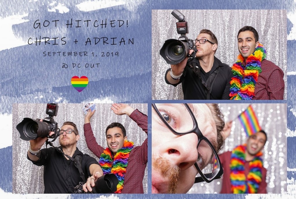 Chris Ferenzi and Jon Fleming posing in a photobooth with a rainbow prop.