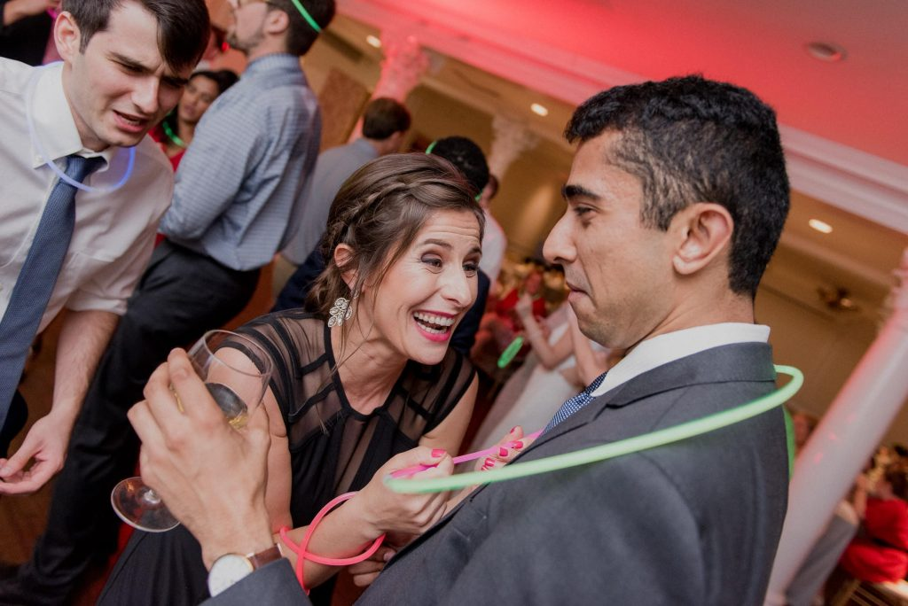 Guests laugh and dance to the music of DJ Romin Zandi.