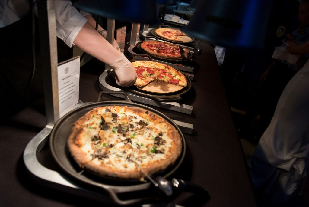 Wood-fired oven cooked pizza from Timber Pizza being served at a wedding.
