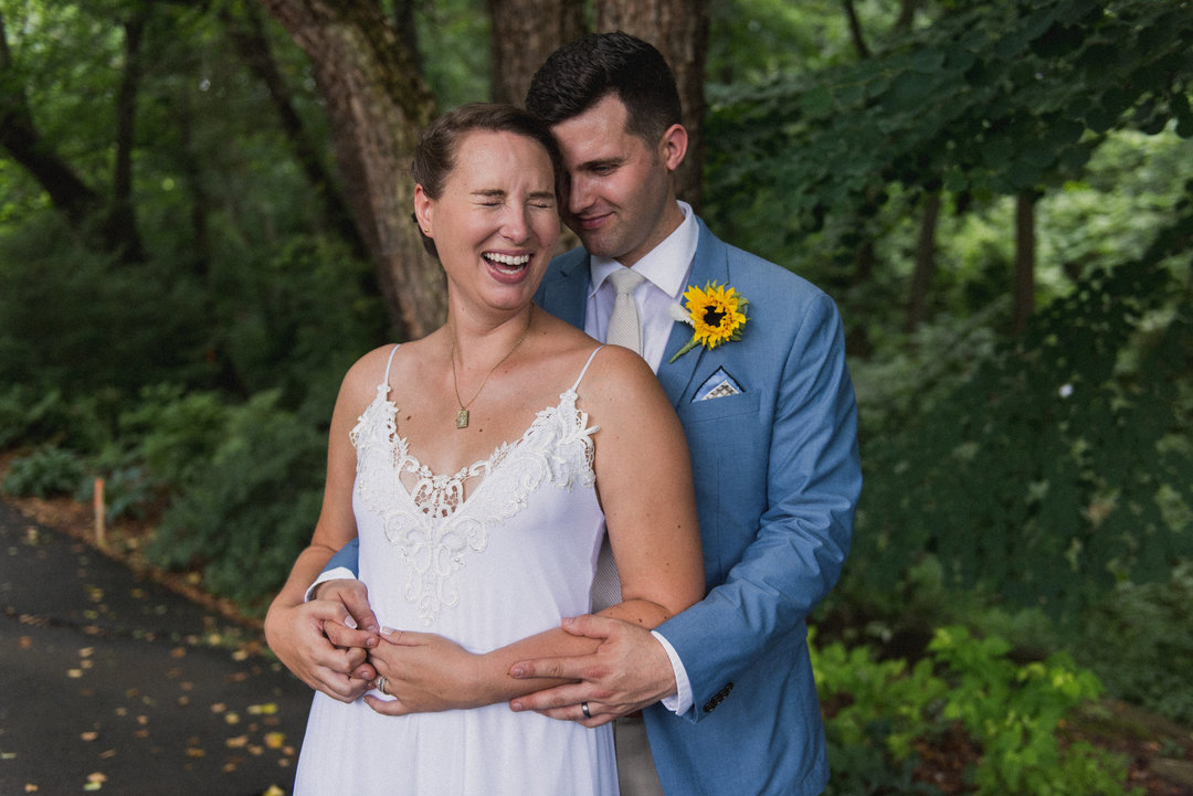 A portrait of a couple laughing after their wedding at the Meadowlark Botanical Gardens in Vienna, Virginia.